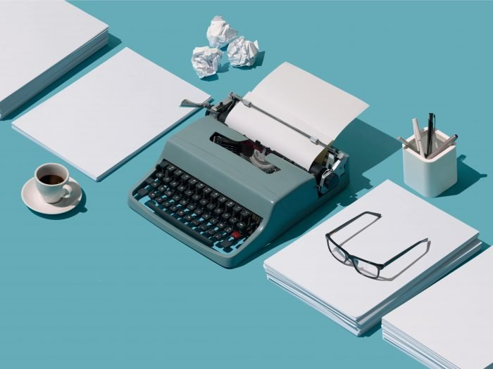 A typewriter and crumpled paper